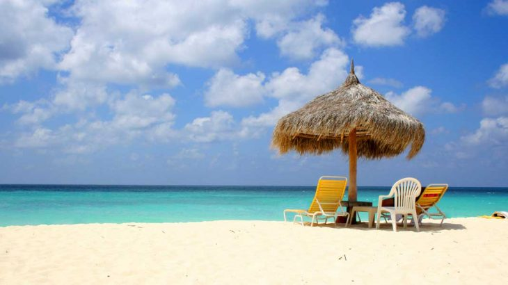beach-umbrella-hut-chairs-turquoise-water-aruba