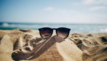 sunglasses-beach-sand-water