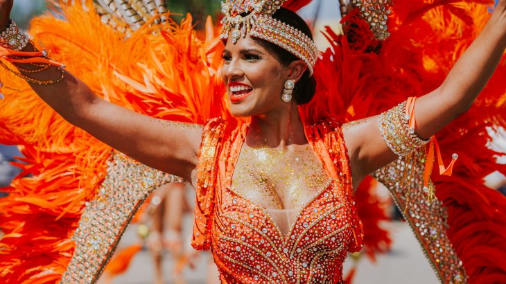 woman-orange-costume-sparkles-carnival-aruba