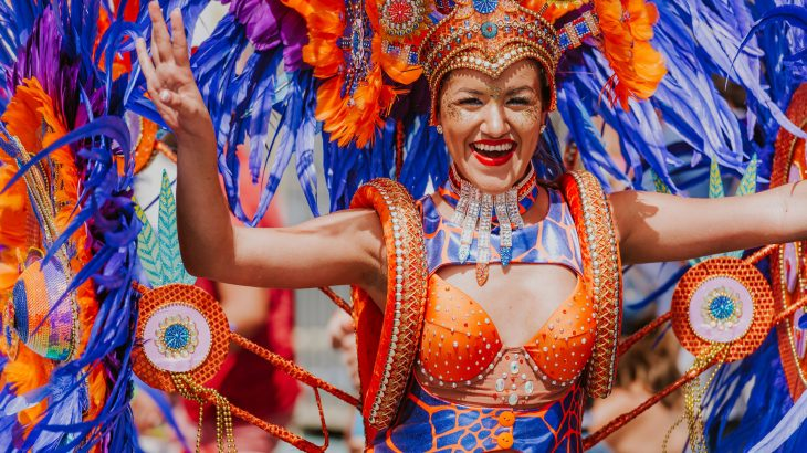 woman-wearing-orange-blue-carnival-costume-aruba