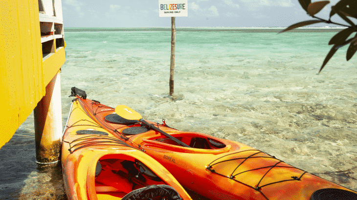 two kayaks outside of overwater yellow bungalow
