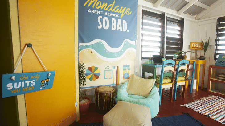 Chair inside office with funny beach signs
