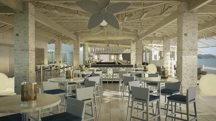 Open air restaurant with white furniture overlooking the ocean