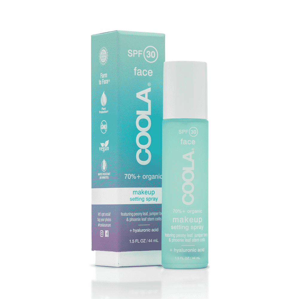 A bottle of Coola makeup setting spray with SPF