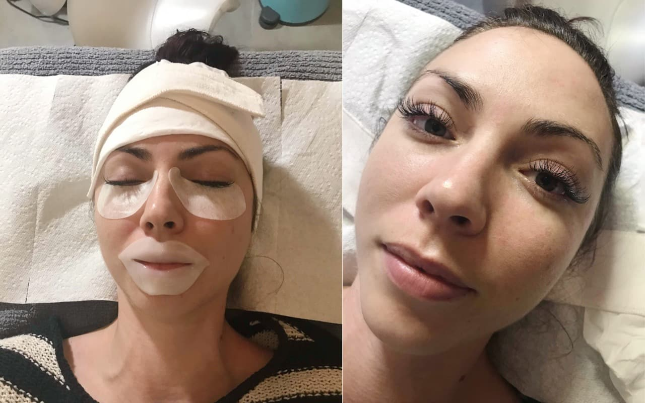 A woman lying on a spa treatment table receives eyelash extensions before her beach vacation