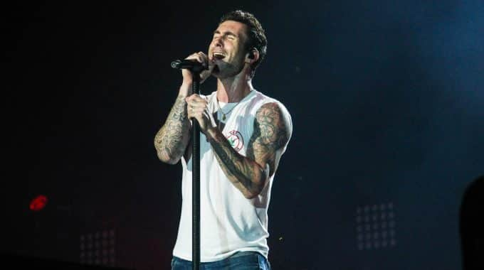 Image of Adam Levine male singer performing in white tank top
