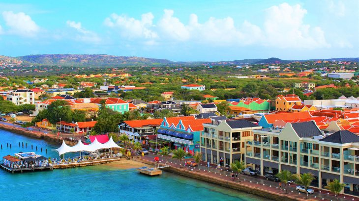 An above shot of Bonaire with colorful shops and restaurants on the oceanfront