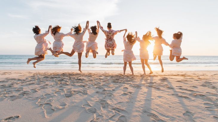 wedding-party-bridesmaids-jumping-beach