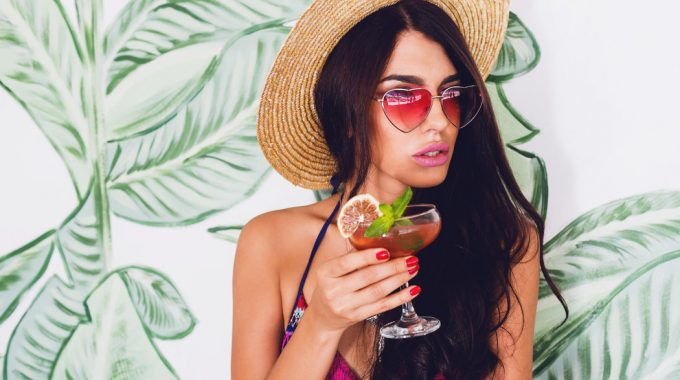 woman-holding-margarita-big-glasses-have-own-margarita-butler-los-cabos-resort