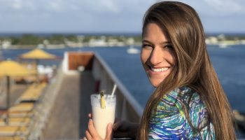 woman-holding-pina-colada-cruise-ship-florida-to-bahamas