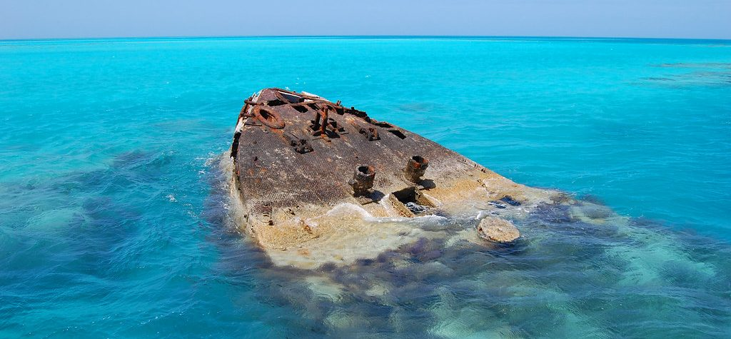 Tip of the Vixen shipwreck in the water in the Bermuda Triangle