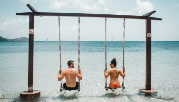 couple-overwater-swings-best-swimsuits-bachelorette-honeymoon