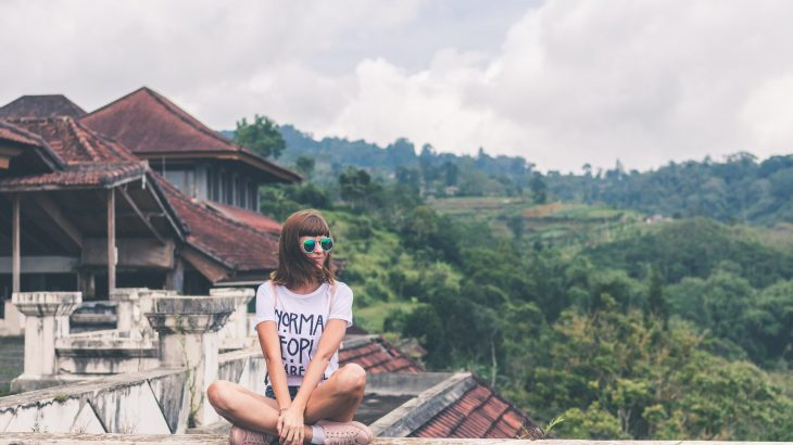 woman-traveler-sitting-on-rooftop