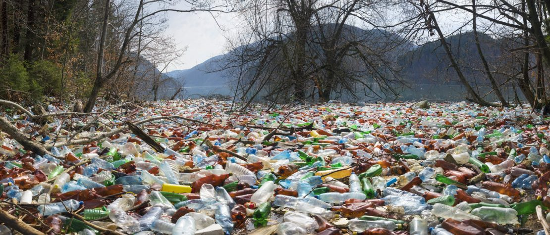 ground-covered-plastic-bottle-pollution-near-water