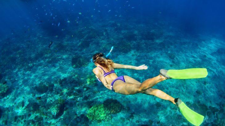 woman underwater snorkeling ocean travel captions for instagram
