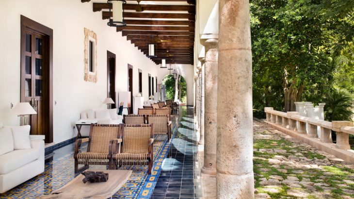 an-outside-patio-with-dark-wood-beams-and-original-Mexican-tile